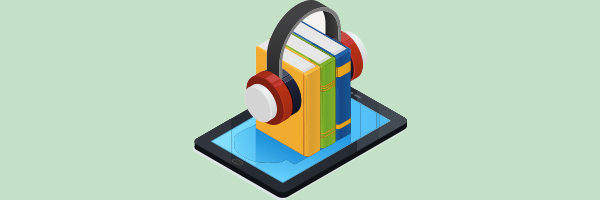 books with headphones ontop of tablet